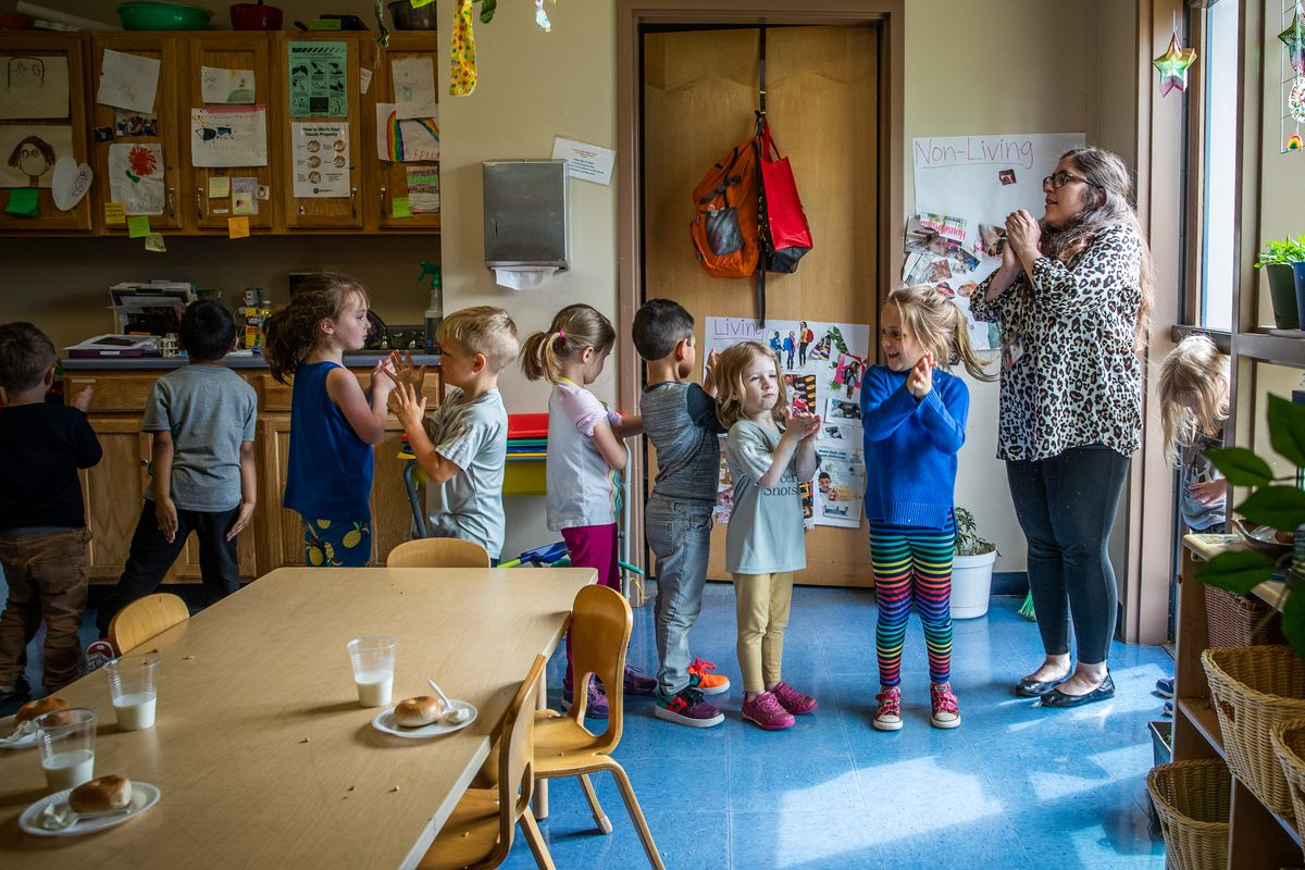 Pre-kindergarten lead teacher Elizabeth Dobrow (right) preps her class to line up before going outside to play at IU Health Day Early Learning Center in Indianapolis on Tuesday, May 14, 2019.