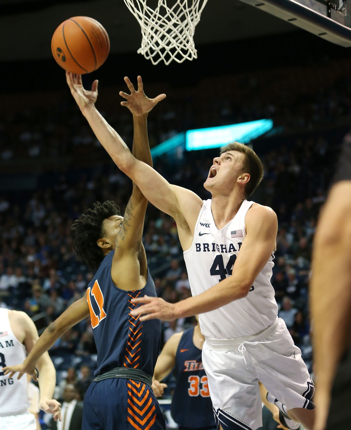 Brigham Young Cougars guard Connor Harding (44) puts up a shot over Cal State Fullerton Titans guard Wayne Arnold (11) as BYU and Cal State Fullerton play a college basketball game at the Marriott Center in Provo on Tuesday, Nov. 5, 2019.