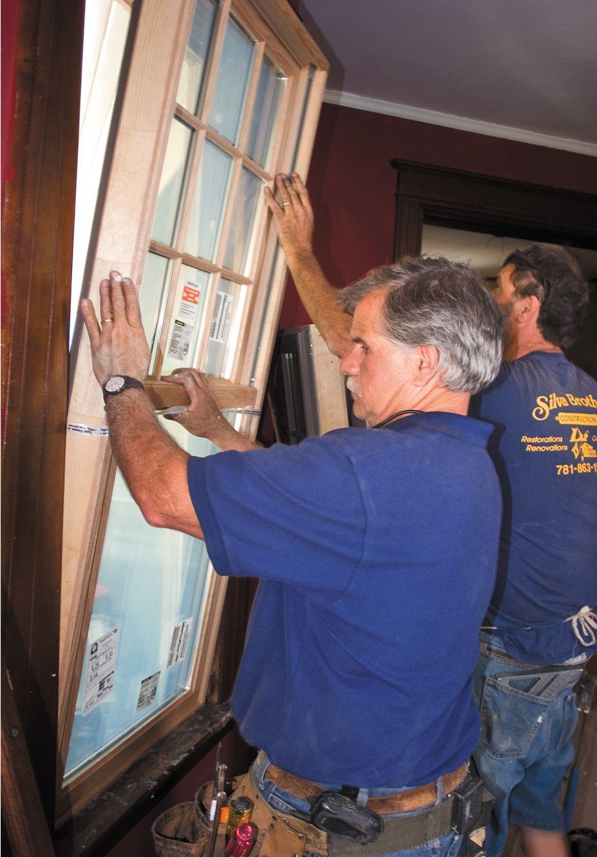 Man Installs New Window