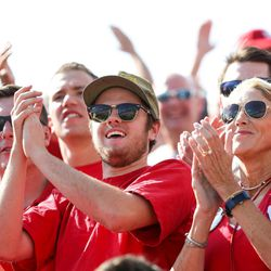 Wisconsin Badgers fans cheer during the game against the BYU Cougars at LaVell Edwards Stadium in Provo on Saturday, Sept. 16, 2017.