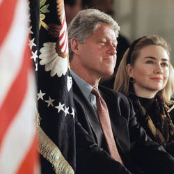 President Bill Clinton and First Lady Hillary Rodham Clinton sit with Mario Hood, 12, student body president of the William Jefferson Clinton Elementary Magnet School in Sherwood, Ark., Jan. 4, 1995. Clinton was introduced by the 6th grade student at dedication ceremonies at the school, which opened in August 1994.