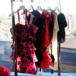 Floral dress, $199; one-shouldered eggplant dres, $199; pink ruffled dress, $199; t-shirt dress, $49.95; navy ruffled dress, $199