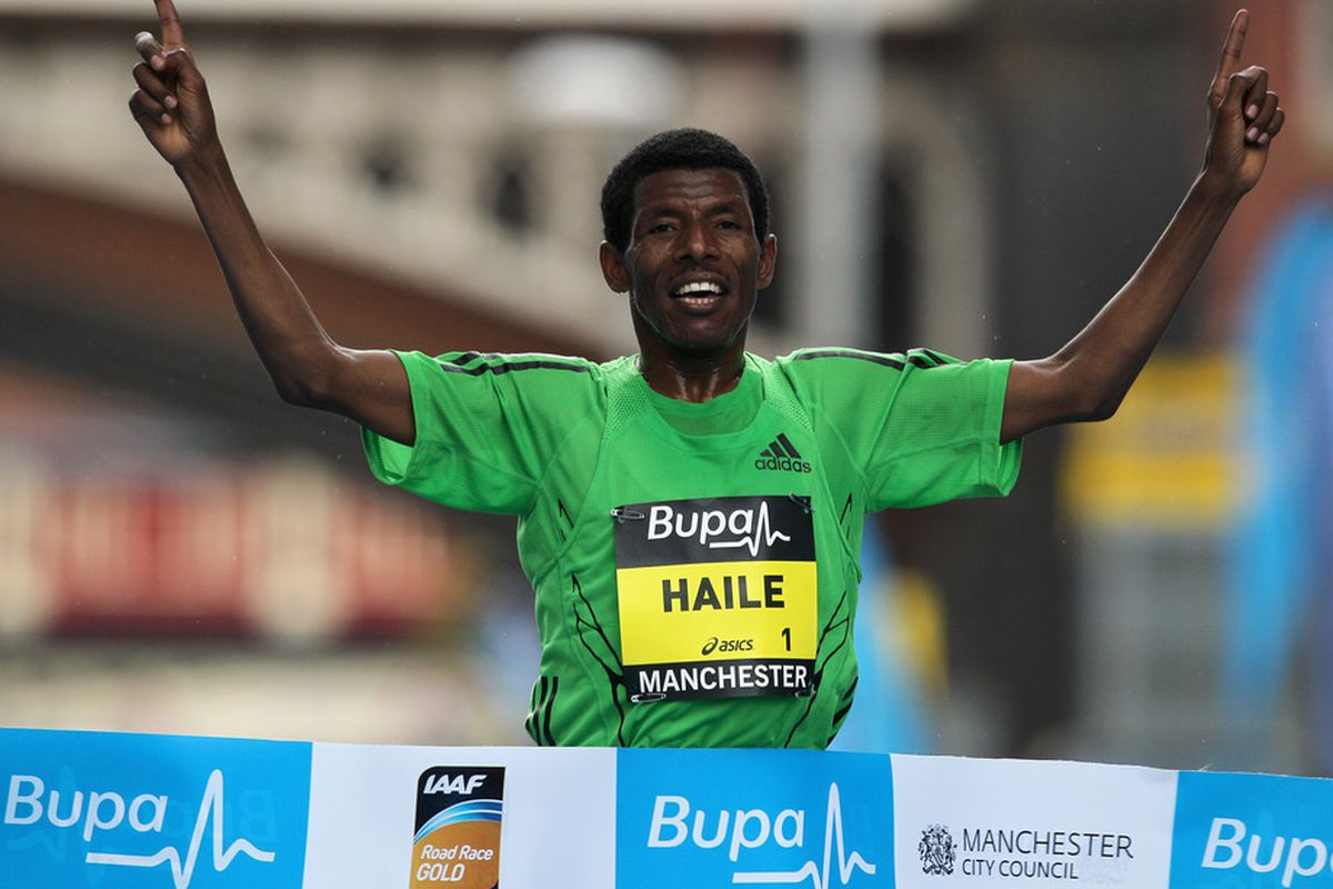 MANCHESTER, ENGLAND - MAY 15:  Haile Gebrselassie of Ethiopia smiles as his crosses the finish line to win the BUPA Great Manchester Run on May 15, 2011 in Manchester, England.  (Photo by Dean Mouhtaropoulos/Getty Images)