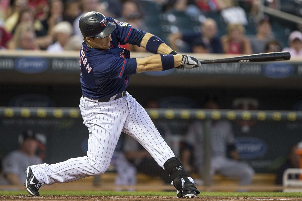 Aug 29, 2012; Minneapolis, MN, USA: Minnesota Twins left fielder Josh Willingham (16) hits a single in the second inning against the Seattle Mariners at Target Field. Mandatory Credit: Jesse Johnson-US PRESSWIRE