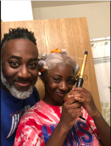 Single dad Laurentio Howard with his daughter, Dnigma Howard, in February, as the two quarantined in their Near West Side home during the coronavirus pandemic. Dnigma graduated May 20 from Innovations High School.