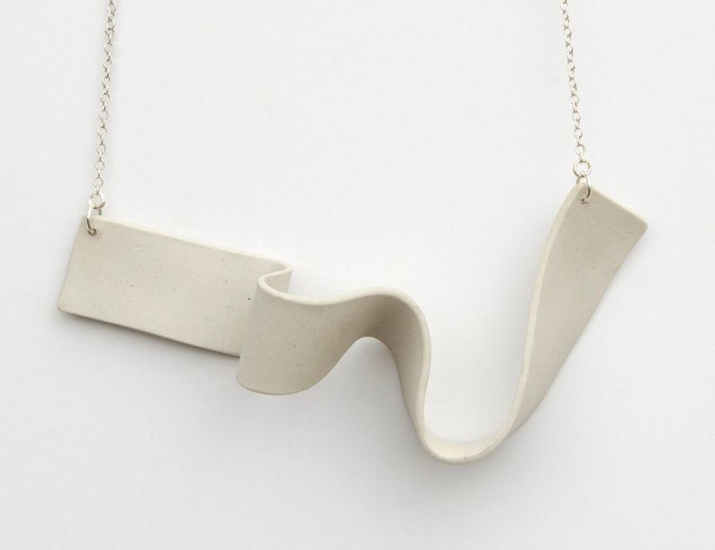 White porcelain wavy necklace on a silver chain.