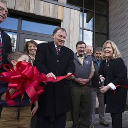 President Henry B. Eyring, first counselor in the First Presidency of the Church of Jesus Christ of Latter-day Saints, left, and Gov. Gary Herbert, left center, help Joan Fenton, of the Sorenson Legacy Foundation, cut the ribbon for the Thomas S. Monson Lodge at the Hinckley Scout Ranch in the Uinta Mountains on Wednesday, Oct. 5, 2016.