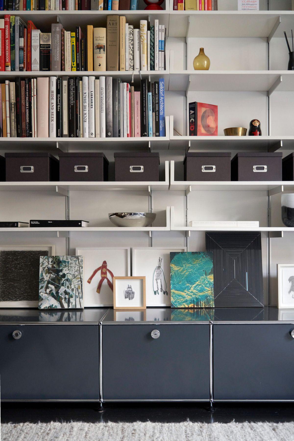 White built-in bookshelves and gray cabinets.