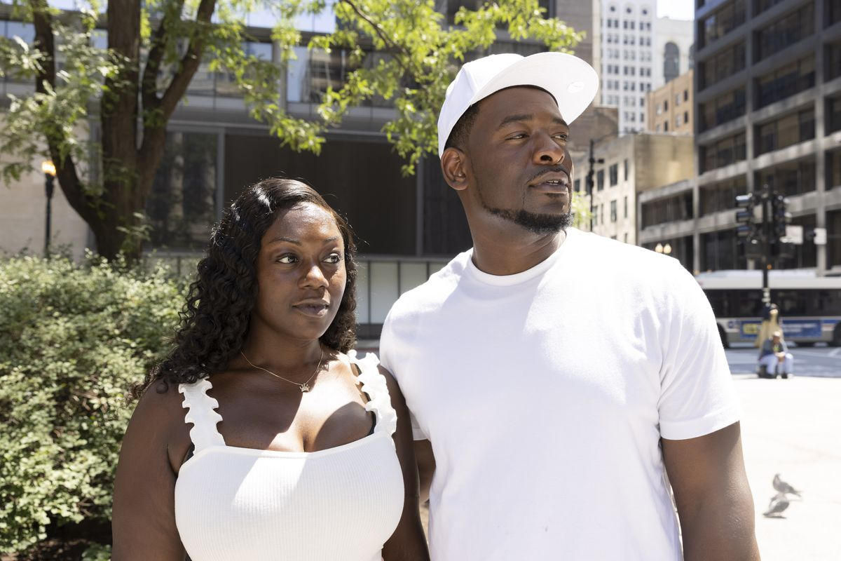 Ariana Walker, left, and Joshua Williams, right, pose for a portrait at Daley Plaza after a press conference to bring attention to the ongoing missing persons case of their son King Walker, Sunday, July 25, 2021.