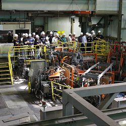 """Dignitaries get a closer look at copper production at Kennecott, including behind-the-scenes looks at the operations of the refinery, tank house, stripping area, bundling and loading during the company's """"Heavy Metal Tour"""" on Wednesday. The copper they're showing off will be sent elsewhere for fabrication and then come back to Utah to be used in the Utah Museum of Natural History's new building, the Rio Tinto Center."""