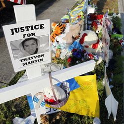 A makeshift memorial for Trayvon Martin is displayed Thursday April 12, 2012, on the sidewalk outside the complex where Martin was shot dead by neighborhood watch volunteer George Zimmerman in Sanford, Fla.  Zimmerman has been charged with second-degree murder in the shooting death of the 17-year-old and is expected in court Thursday.