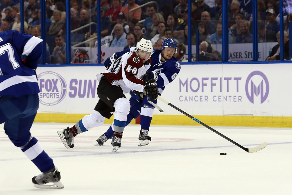 Colorado's Alex Tanguay and Tampa Bay's Anton Stralman chase the puck during the Lightning's 2-1 loss to the Avalanche in Tampa Thursday night.