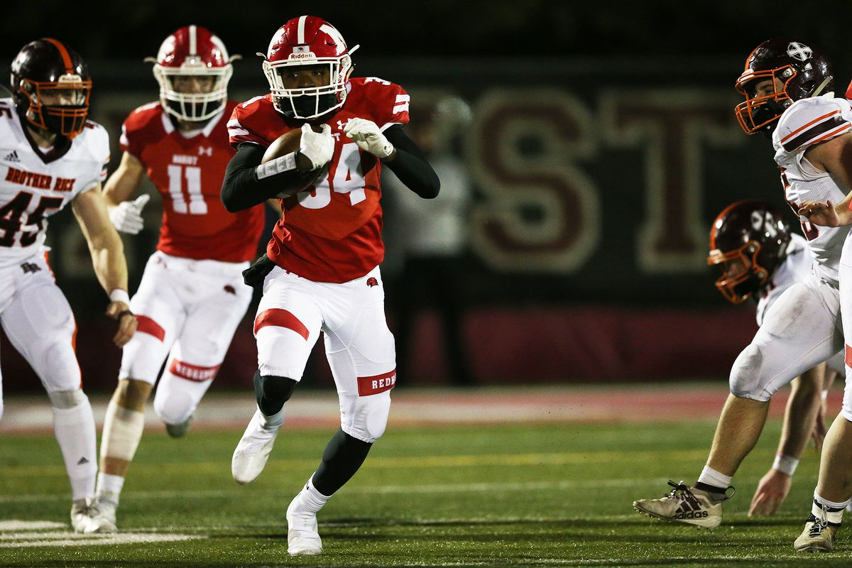 Marist's Jamari Grant (34) powers up the field against Brother Rice.