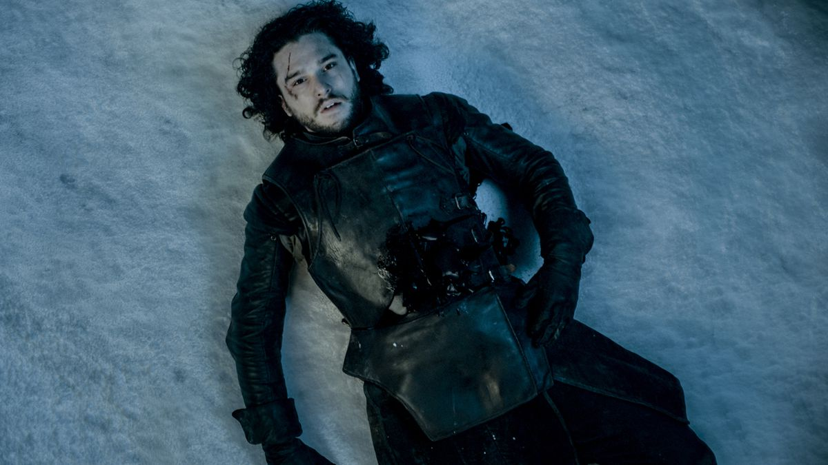 Jon Snow lying in the Snow after being attacked and killed by his own men.