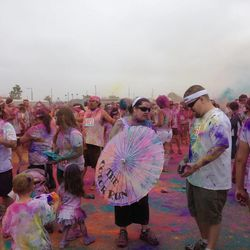 People bring all kinds of white objects to see them splashed with color at The Color Run 5K.