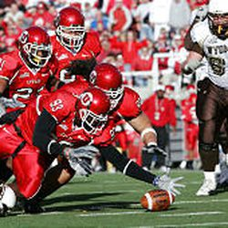 Led by Martail Burnett (93), Ute defenders close in on a Wyoming fumble during Saturday's game.