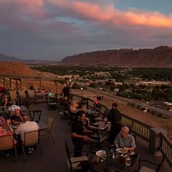 People dine at the Sunset Grill, a popular restaurant for tourists, in Moab on Wednesday, Sept. 7, 2016. Once known as the uranium capital of the country, Moab turned to tourism when the uranium mining boom collapsed.