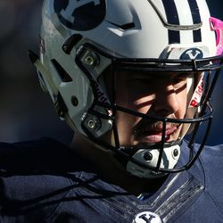 BYU quarterback Tanner Mangum warms up before a game against the UMass Minutemen at LaVell Edwards Stadium in Provo on Saturday, Nov. 19, 2016.