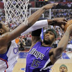 Sacramento Kings forward DeMarcus Cousins, right, puts up a shot as Los Angeles Clippers center DeAndre Jordan defends during the first half of their NBA basketball game, Saturday, April 7, 2012, in Los Angeles.