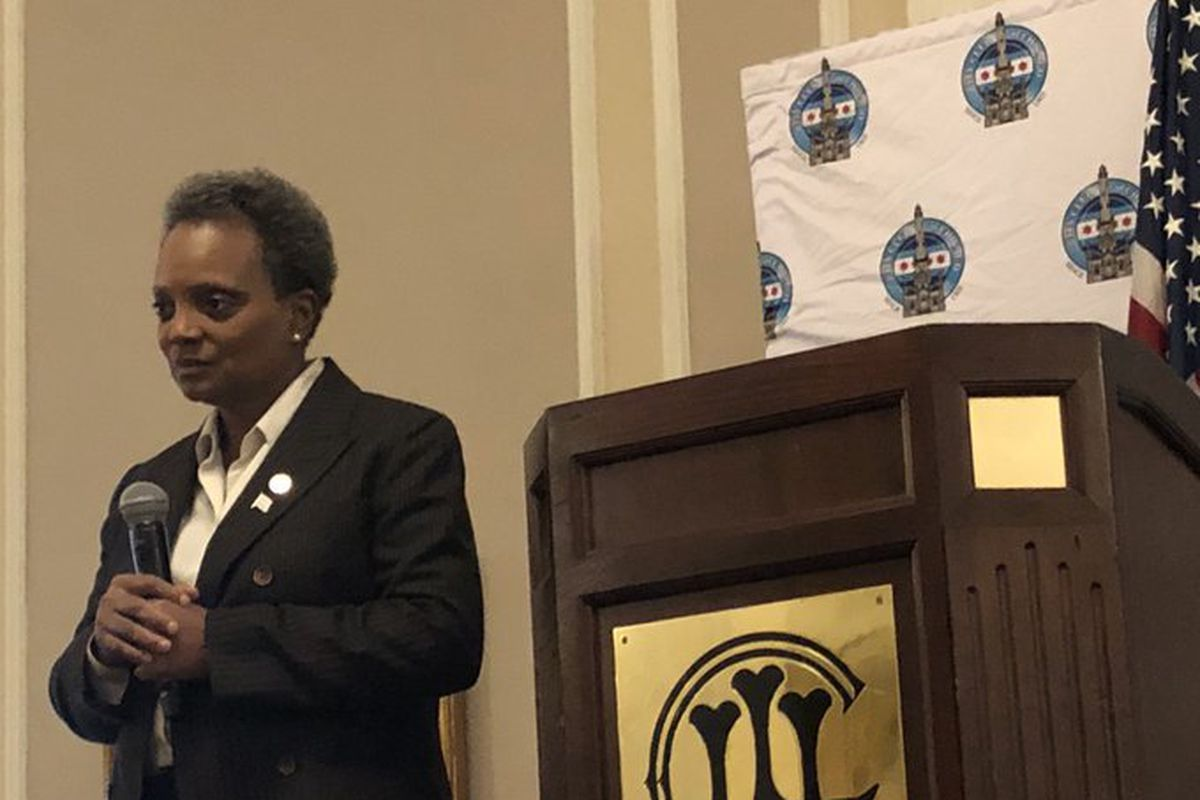 Mayor Lori Lightfoot talks to reporters after speaking to the City Club of Chicago.