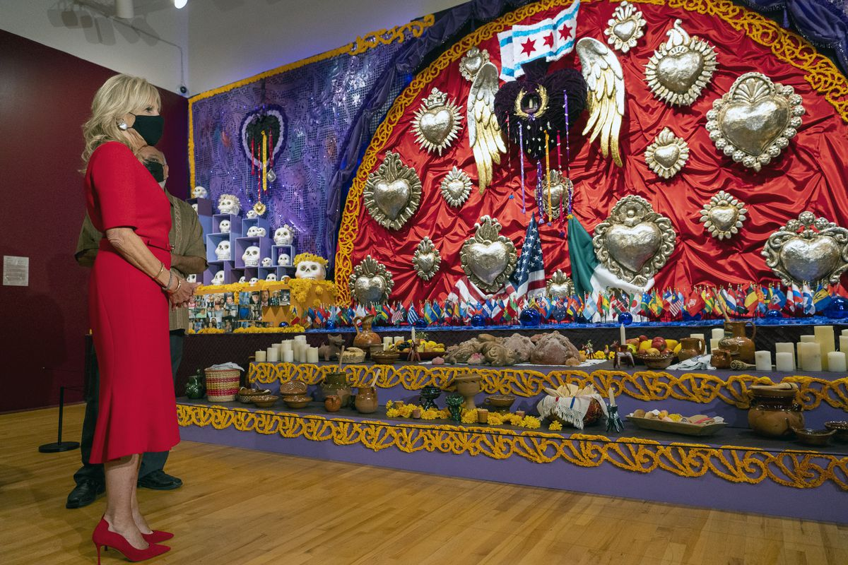First lady Jill Biden views a Day of the Dead Exhibit during a tour of the National Museum of Mexican Art in Pilsen with chief curator Cesareo Moreno on Tuesday.