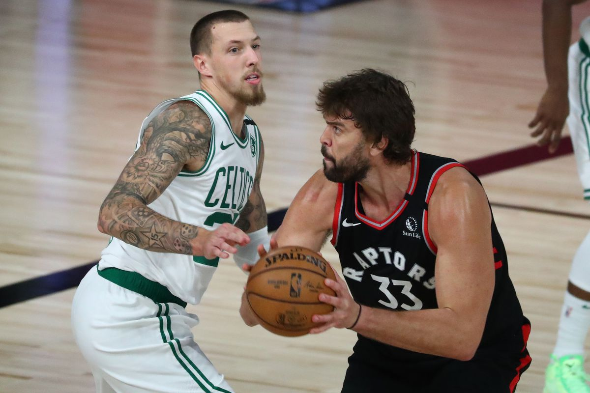 Toronto Raptors center Marc Gasol drives against Boston Celtics center Daniel Theis during the second half of game four in the second round of the 2020 NBA Playoffs at ESPN Wide World of Sports Complex.