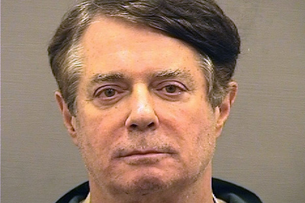 Paul Manafort poses for a mugshot photo at the Alexandria Detention Center in Alexandria, Virgina. Manafort has been charged with money laundering and bank fraud, among other violations.