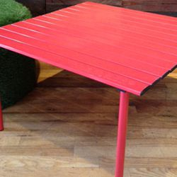 """For those picnics that require a stable surface. Table In A Bag in Red, <a href=""""http://aandgmerch.com/table-in-a-bag-red-low-aluminum.html"""">$22</a> (from $59) at A&G Merch"""