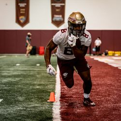 RB transfer La'Damion Webb (#8) with the ball in hand.