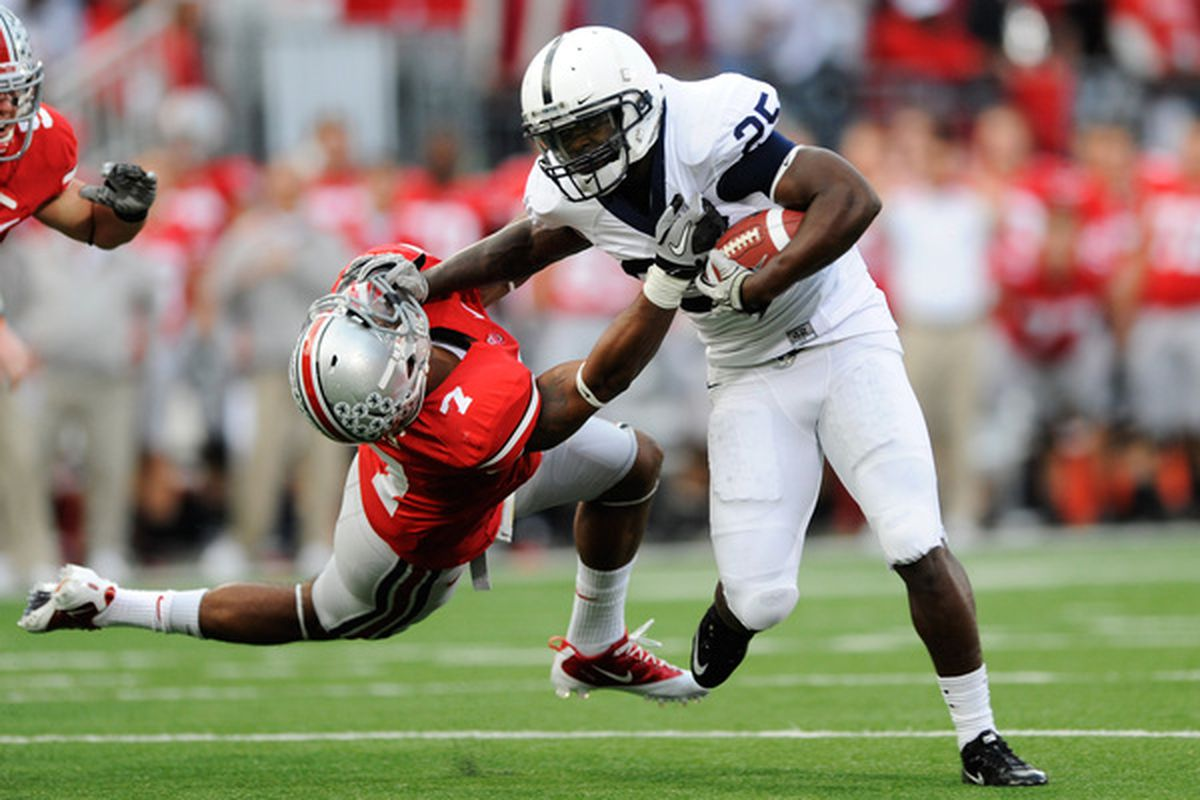 COLUMBUS OH - NOVEMBER 13:  Silas Redd #25 of the Penn State Nittany Lions PWNS THE SHIT OUT OF Jermale Hines #7 of the Ohio State Buckeyes at Ohio Stadium on November 13 2010 in Columbus Ohio.  (Photo by Jamie Sabau/Getty Images)