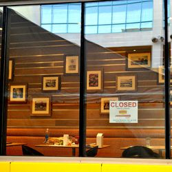 Photographs of diners on the wall.