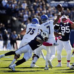Brigham Young Cougars defensive lineman Sione Takitaki hits San Jose State Spartans quarterback Montel Aaron during NCAA football in Provo on Saturday, Oct. 28, 2017.