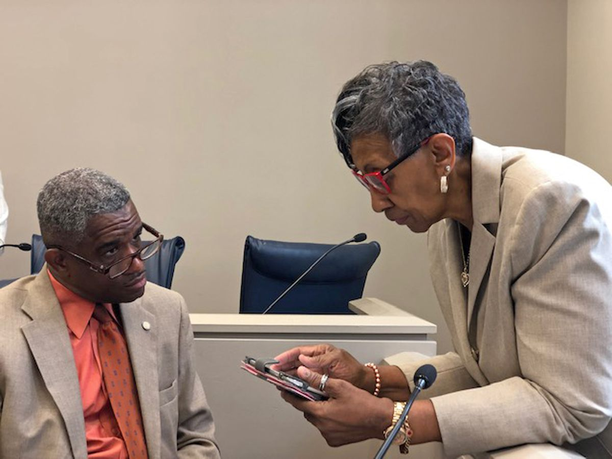 Ald. Carrie Austin (34th) talks to Ald. David Moore (17th) on Monday at City Hall.