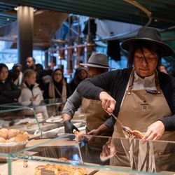 Starbucks staff serve customers on opening day of the Starbucks Reserve Roastery in Chicago.