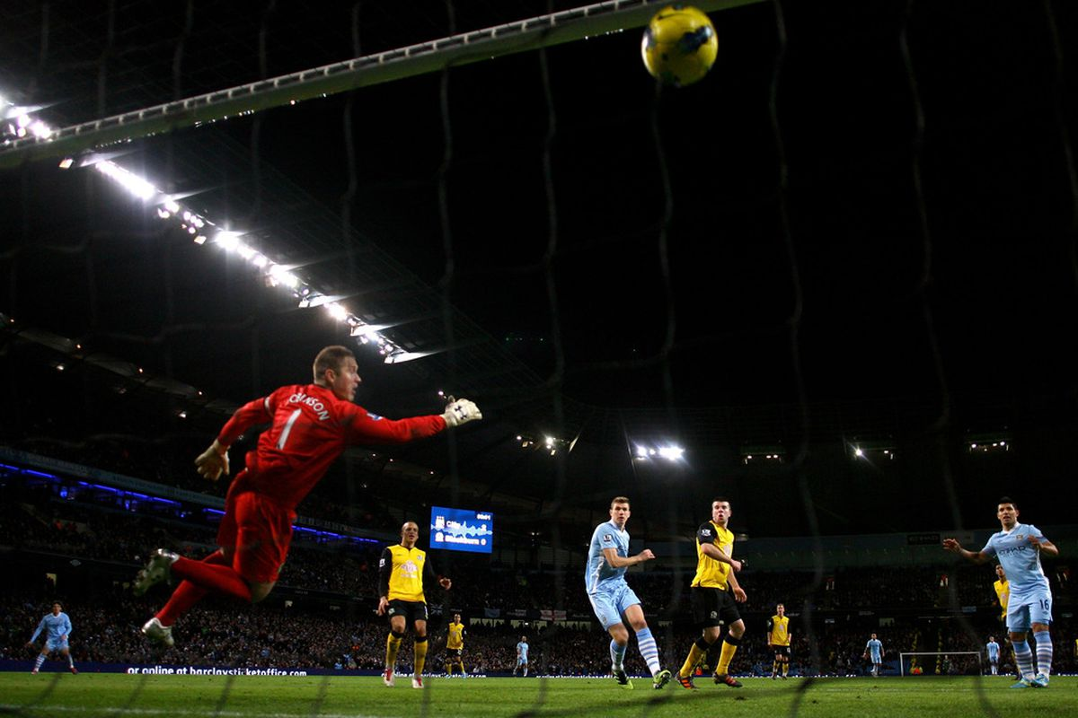 Edin Dzeko is a tall player who scores with his head often. Does Barcelona need to look for that kind of player in the transfer market? (Photo by Alex Livesey/Getty Images)