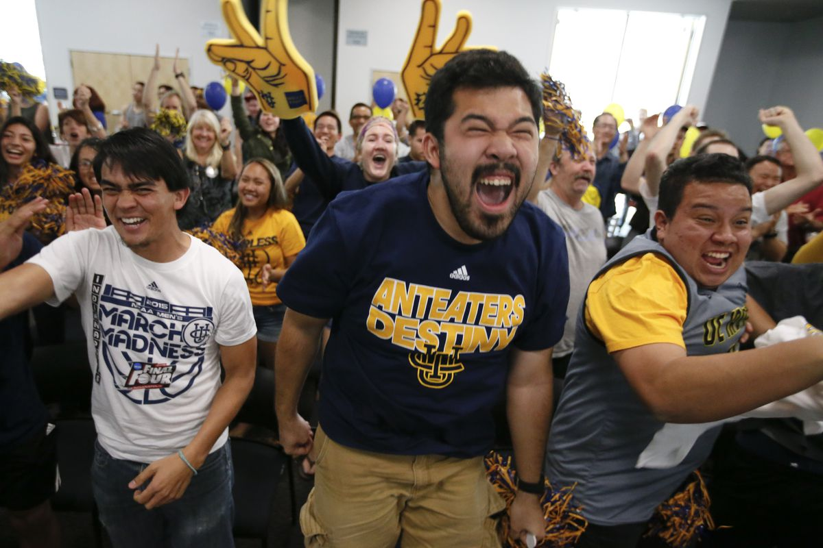 Emotions are high at UC Irvine today while students (lt to rt) Sean Burke, Mark Barcelona and Dony Rivas are elated to see their Anteaters basketball team pull ahead of the Louisville Cardinals late in the second half of the NCAA men's basketball tournament opening game.