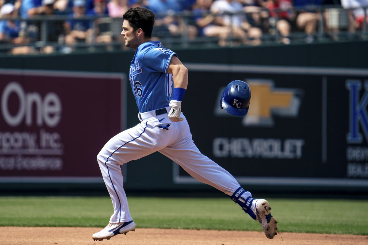 Andrew Benintendi #16 of the Kansas City Royals heads to third to complete the triple play against the Minnesota Twins in the third inning at Kauffman Stadium on June 5, 2021 in Kansas City, Missouri.