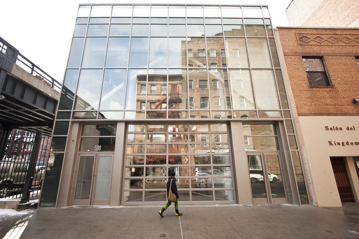 [The sales office for 500 W 21 is across the High Line from the building site.]