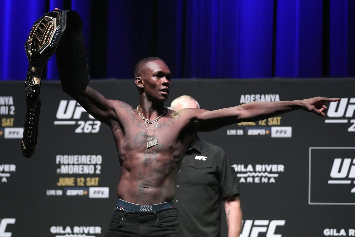 Israel Adesanya of Nigeria poses for photos during the UFC 263 press conference at Arizona Federal Theater on June 10, 2021 in Phoenix, Arizona.