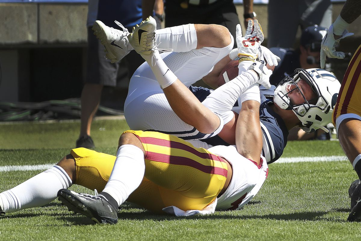Brigham Young Cougars wide receiver Dax Milne (82) catches a touchdown over USC Trojans cornerback Chase Williams (7) in Provo on Saturday, Sept. 14, 2019.