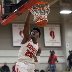 Benet Academy's Kendrick Tchoua (25) dunks against Stevenson during their 63-59 win in Lisle, Saturday, February 16, 2019.   Kevin Tanaka/For the Sun Times