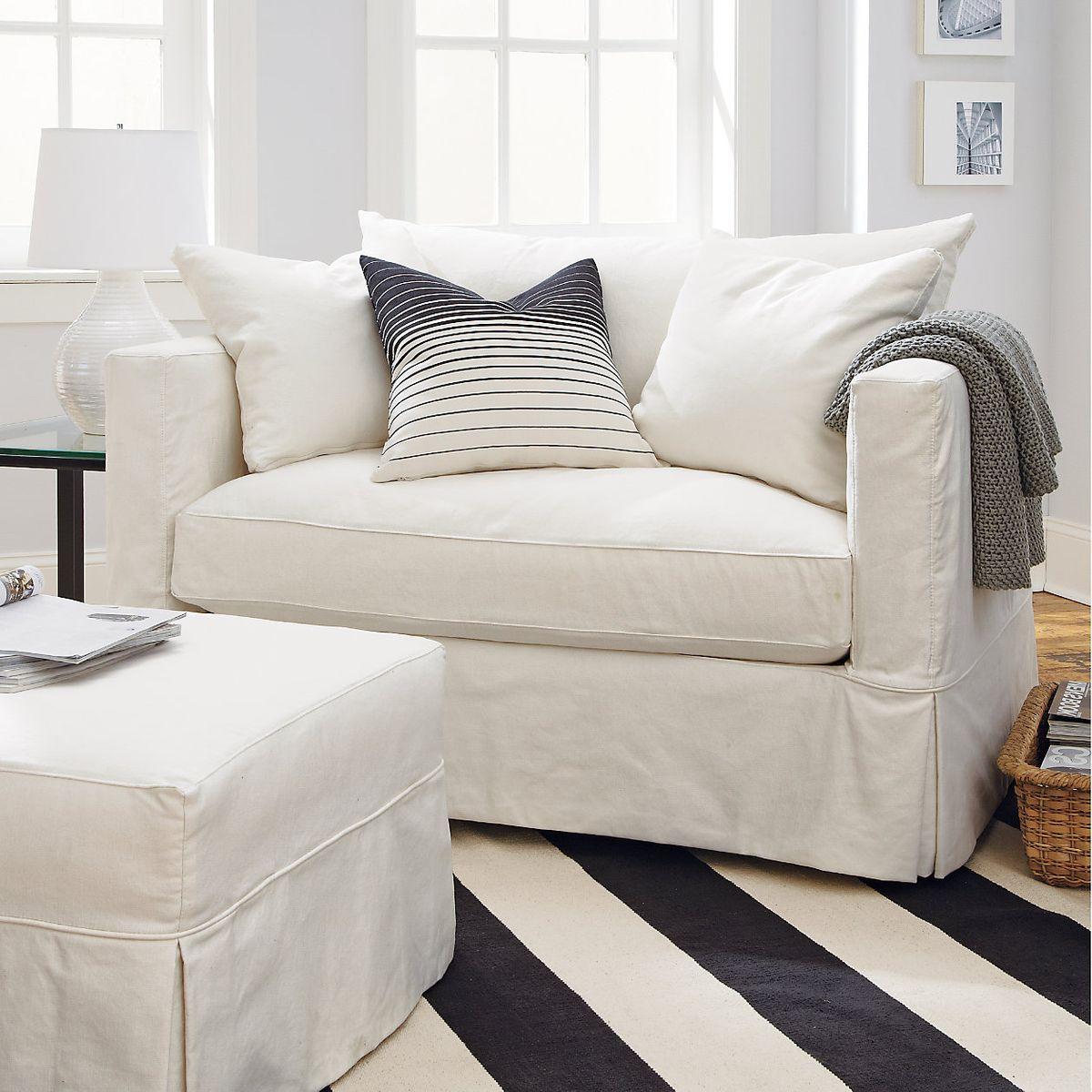Cream one-seat sofa.