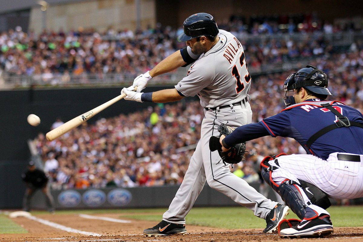 Detroit Tigers catcher Alex Avila hits an RBI double in the second inning against the Minnesota Twins at Target Field.