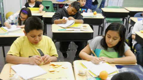 Fourth-graders at Alsup Elementary in Commerce City have breakfast in the classroom.