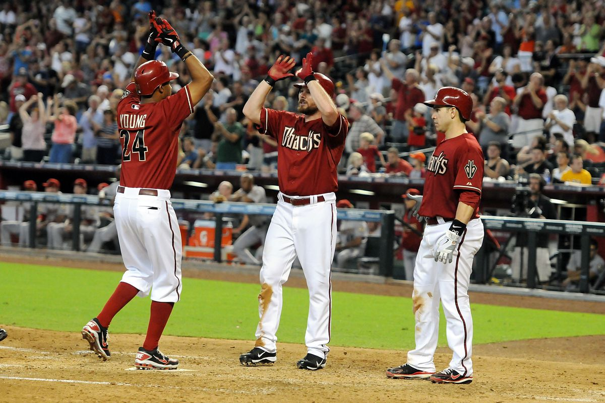 PHOENIX, AZ - JULY 22:  Chris Young #24, Jason Kubel #13 and Miguel Montero #26 of the Arizona Diamondbacks celebrate a home run against the Houston Astros at Chase Field on July 22, 2012 in Phoenix, Arizona.  (Photo by Norm Hall/Getty Images)