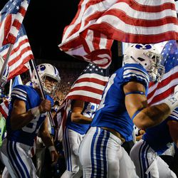 BYU players make their way onto the field ahead of an NCAA college football game against Utah at LaVell Edwards Stadium in Provo on Saturday, Sept. 11, 2021.