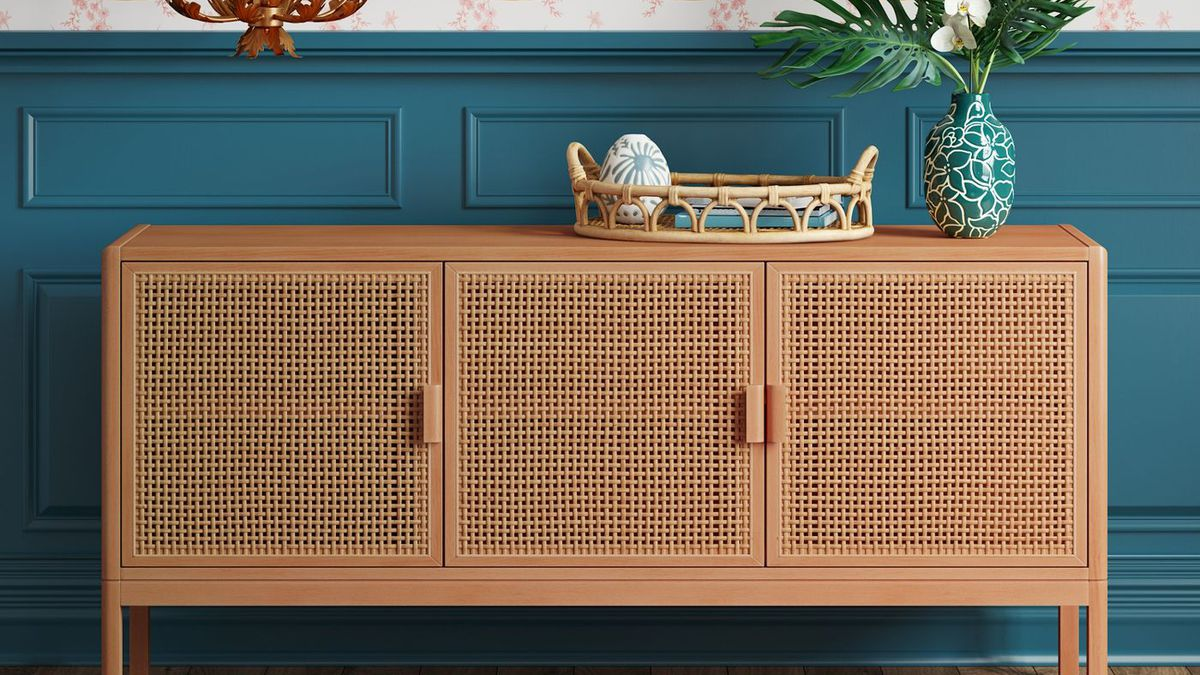 Wooden TV stand with woven panels in the front.