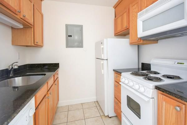 A small kitchen with counters on either side.