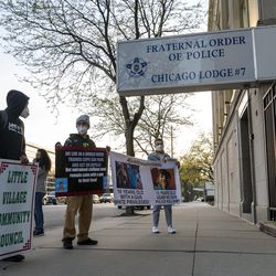 A small group of activists rally in front of the Fraternal Order of Police Chicago Lodge #7, Friday, April 30, 2021.