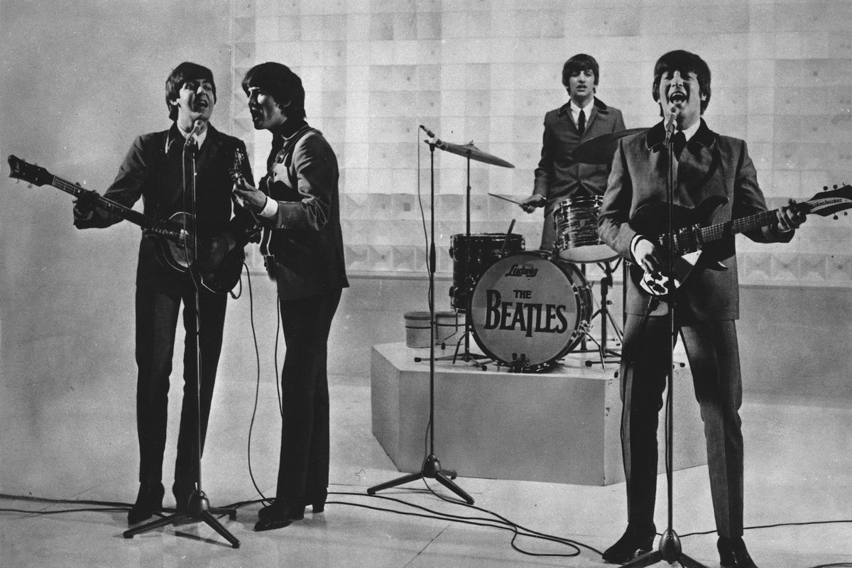 """The Beatles are seen performing, date unknown. From left to right: Paul McCartney, George Harrison, Ringo Starr, and John Lennon. McCartney has revisited the breakup of The Beatles, refuting the suggestion that he was responsible for the group's demise. Speaking on an episode of BBC Radio 4's """"This Cultural Life'' that is scheduled to air Oct 23, McCartney said it was John Lennon who wanted to disband The Beatles."""